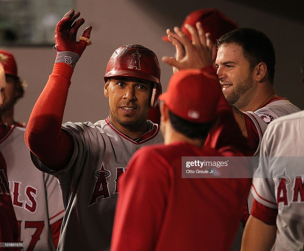 Juan Rivera #20 of the Los Angeles Angels of Anaheim celebrates with teammates after hitting a home run against the Seattle Mariners at Safeco Field on June 4, 2010 in Seattle, Washington.