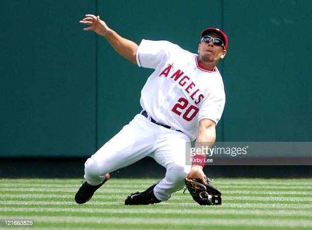 Juan Rivera of the Los Angeles Angels of Anaheim makes a sliding catch during 42 victory over the Los Angeles Dodgers in Interleague Exhibition...
