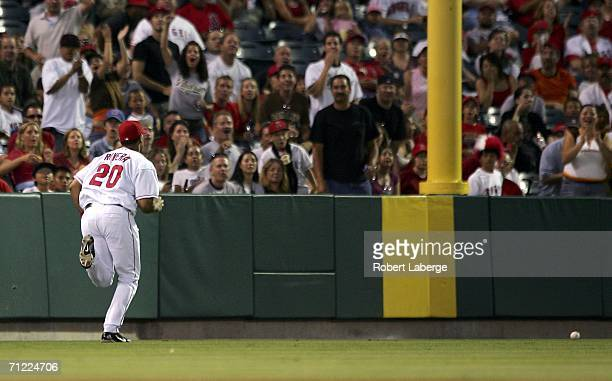 Juan Rivera of the Los Angeles Angels of Anaheim runs after the ball after misjudging its trajectory during the game against the San Diego Padres on...