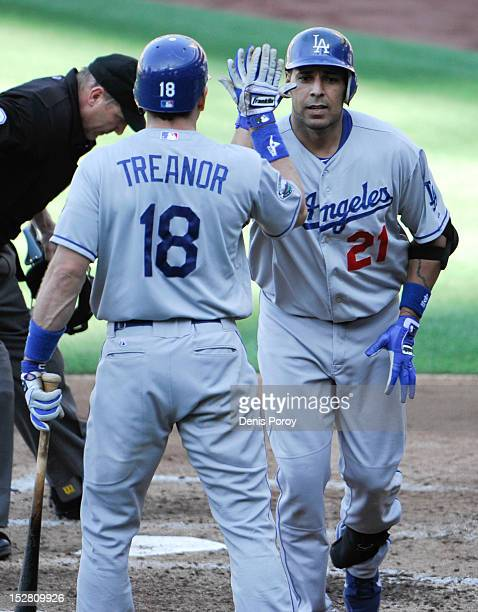 Juan Rivera of the Los Angeles Dodgers is congratulated by Matt Treanor after hitting a solo home run during the fourth inning of a baseball game...
