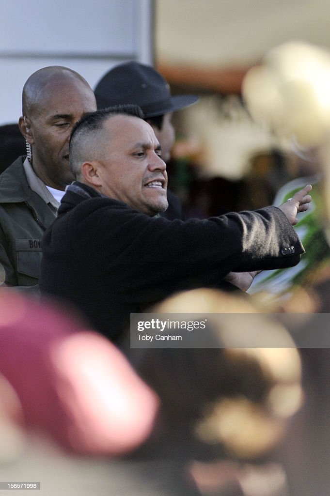 Juan Rivera tries to control the crowd at sister Jenni Rivera's memorial ceremony held at Gibson Amphitheatre on December 19, 2012 in Universal City, California.