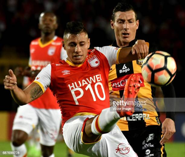 Juan Roa of Independiente Santa Fe fights for the ball with Pablo Escobar of The Strongest during a match between Independiente Santa Fe and The...