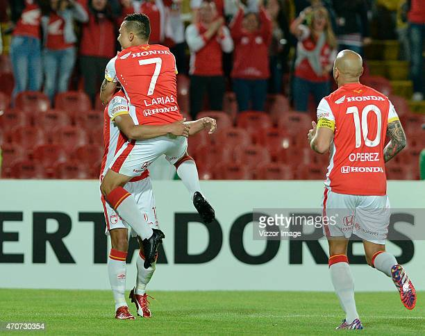 Juan Roa of Santa Fe celebrates with Luis Arias after scoring the second goal of their team during a group 1 match between Santa Fe and Atlas as part...