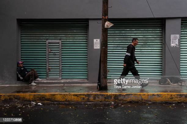 Juan Rodríguez Molina sits on a sidewalk in the Buenavista neighborhood on June 20 2020 in Mexico City Mexico Nicky Castelan a HIV positive trans sex...