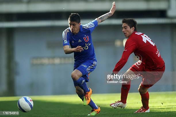 Juan Rodrigo Rojas of Universidad de Chile, struggles for the ball with Yonathan Suazo of Ñublense during a match between Universidad de Chile and...