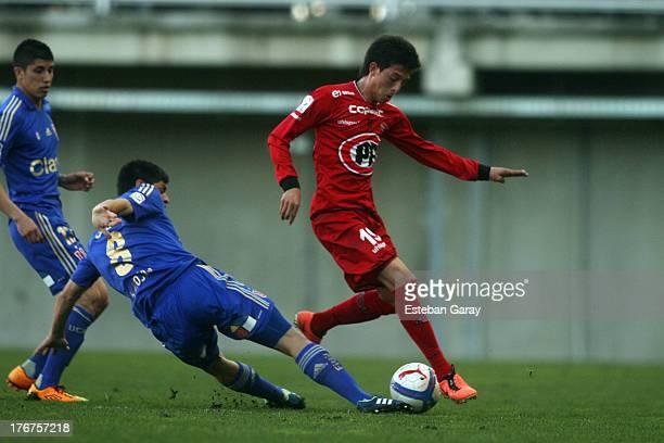 Juan Rodrigo Rojas of Universidad de Chile, struggles for the ball with Pablo Parra of Ñublense during a match between Universidad de Chile and...