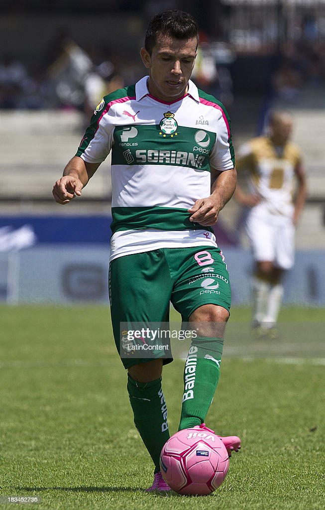 Juan Rodriguez of Santos controls the ball during a match between Pumas and Santos as part of the Apertura 2013 Liga MX at Olympic Stadium on October 06, 2013 in Mexico City, Mexico.