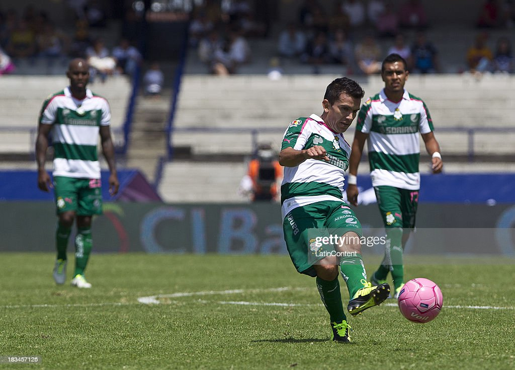 Juan Rodriguez of Santos in action during a match between Pumas and Santos as part of the Apertura 2013 Liga MX at Olympic Stadium on October 06, 2013 in Mexico City, Mexico.