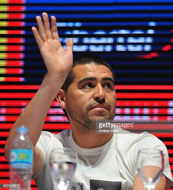 Juan Roman Riquelme greets during a press conference after his official unveiling as a new Argentinos Jrs player at Panamericano Hotel on July 20,...