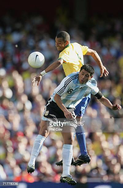 Juan Roman Riquelme of Argentina gets tackled by Gilberto Silva of Brazil during International Friendly match between Brazil and Argentina at The...