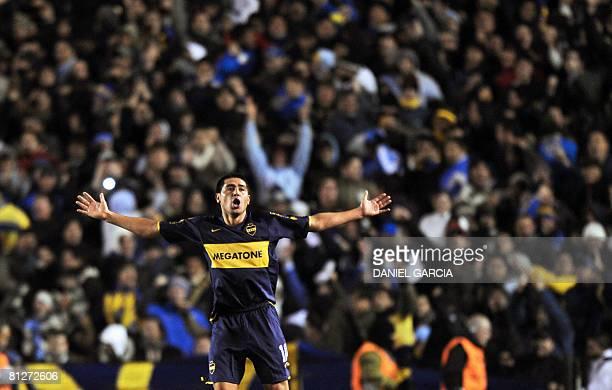 Juan Roman Riquelme of Argentina's Boca Juniors celebrates after scoring the second goal of his team against Brazilian Fluminense during their 2008...