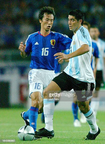 Juan Roman Riquelme of Argentine National Team and Toshiya Fujita of Japan in action