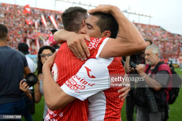 Juan Roman Riquelme of Argentinos Juniors celebrates with teammate Gonzalo Castillejos the promotion to Primera Division after a match between...