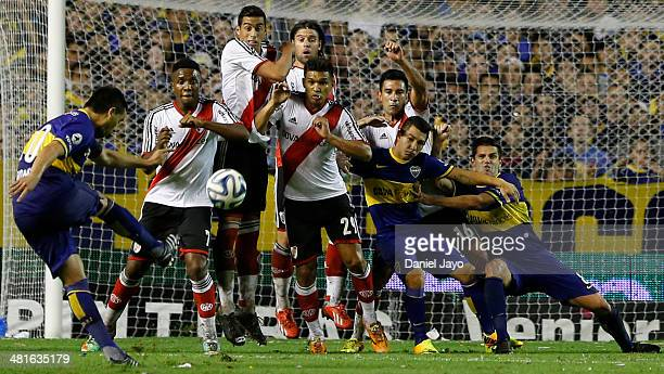 Juan Roman Riquelme, of Boca Juniors, takes a free kick to score during a match between Boca Juniors and River Plate as part of 10th round of Torneo...