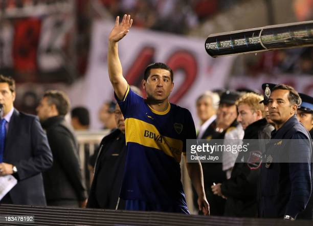 Juan Roman Riquelme of Boca Juniors waves to River Plte's supporters after being substituted during a match between River Plate and Boca Juniors as...