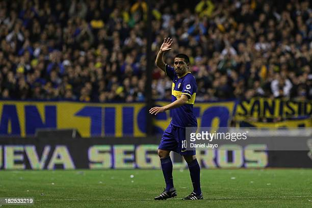 Juan Roman Riquelme of Boca Juniors waves to supporters during a match between Boca Juniors and Quilmes as part of the Torneo Inicial 2013 at Alberto...