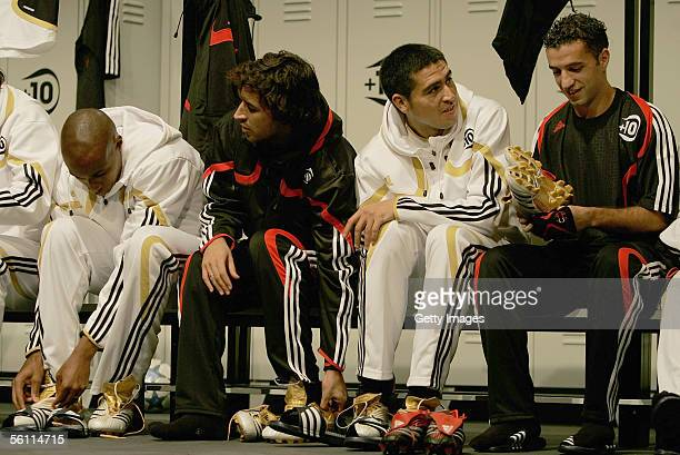 Juan Roman Riquelme sits with other players during the Adidas press launch of the new Predator Football boot on November 3 2005 in Las Rozas Madrid