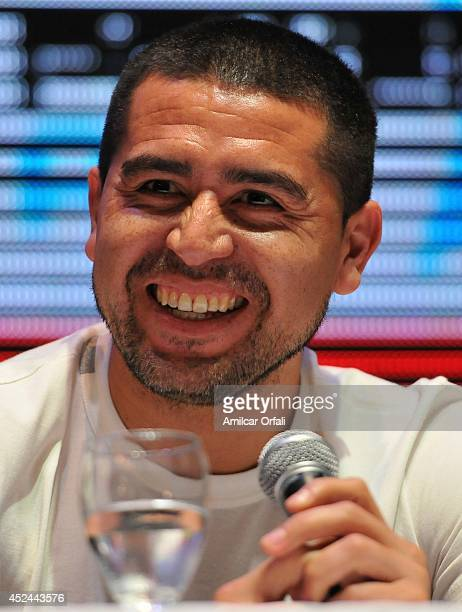 Juan Roman Riquelme smiles during a press conference after his official unveiling as a new Argentinos Jrs player at Panamericano Hotel on July 20,...