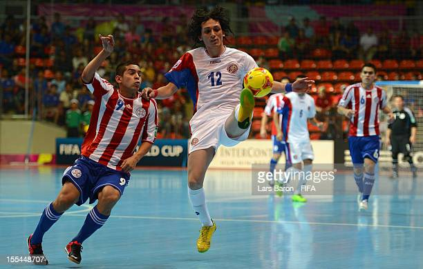 Juan Salas of Paraguay challenges Diego Zuniga of Costa Rica during the FIFA Futsal World Cup Group A match between Paraguay and Costa Rica at Indoor...