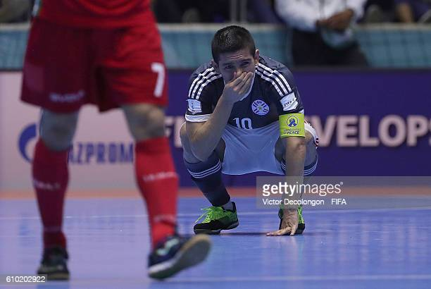 Juan Salas of Paraguay looks on dejected after a goal by Ahmad Esmaeilpour of Iran late in the second half of extra time during quarterfinal match...