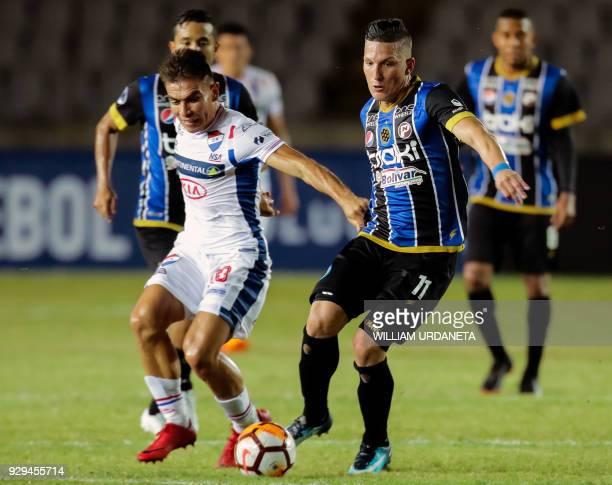 Juan Salgueiro of Paraguay's Nacional vies for the ball with Charlis Ortiz of Venezuela's Mineros during their Copa Sudamericana 2018 football match...