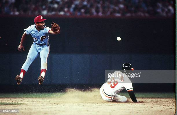 Juan Samuel of the Philadelphia Phillies leaps for the ball at second base during World Series game one between the Philadelphia Phillies and...