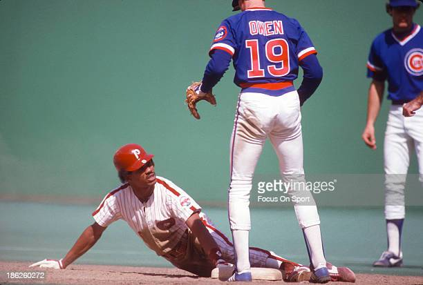 Juan Samuel of the Philadelphia Phillies slides into second base safe against the Chicago Cubs during an Major League Baseball game circa 1984 at...