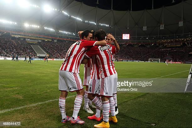 Juan Sanchez Miño of Estudiantes celebrates with teammates after scoring the first goal during a match between Estudiantes and Racing Club as part of...