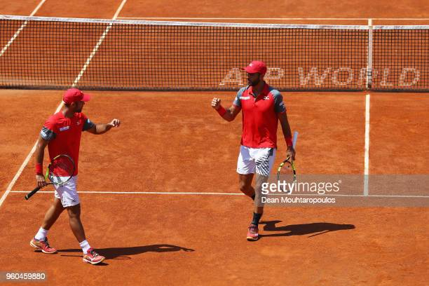 Juan Sebastian Cabal and Robert Farah both of Colombia celebrate a point in their Mens doubles final match against Pablo Carreno Busta of Spain and...
