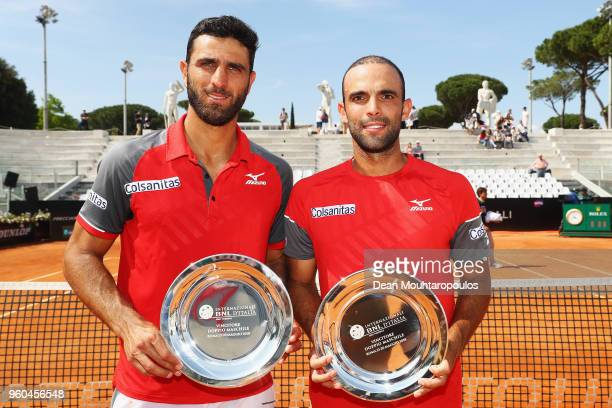Juan Sebastian Cabal and Robert Farah both of Colombia pose with the trophy after victory in their Mens doubles final match against Pablo Carreno...