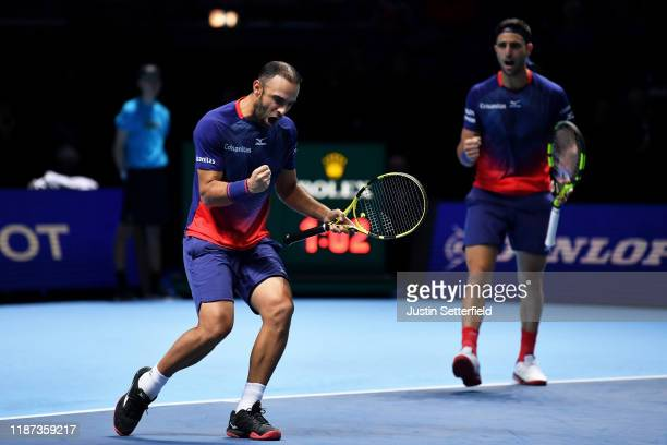 Juan Sebastian Cabal and Robert Farah of Colombia celebrate in their doubles match against JeanJulien Rojer of The Netherlands and Horia Tecau of...