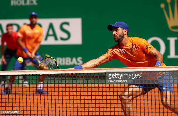 Juan Sebastian Cabal and Robert Farah of Columbia in action against Novak Djokovic and Marko Djokovic of Serbia in their first round doubles match...
