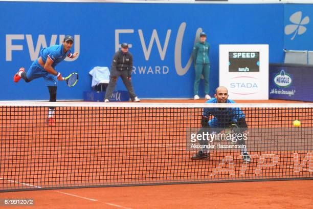 Juan Sebastian Cabal and Robert Farah of Columbia play the ball against Jeremy Chardy and Fabrice Martin of Francve during their finale match of the...