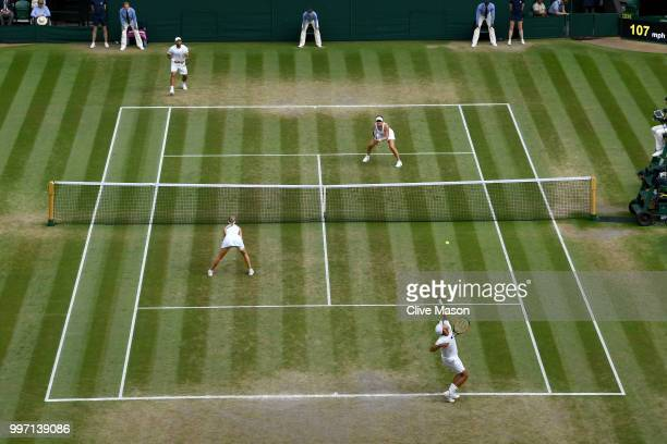 Juan Sebastian Cabal of Colombia and Abigail Spears of the United States in action against Jay Clarke and Harriet Dart of Great Britain return...