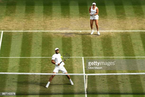 Juan Sebastian Cabal of Colombia and Abigail Spears of the United States return against Jay Clarke and Harriet Dart of Great Britain return against...