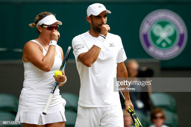 Juan Sebastian Cabal of Colombia and Abigail Spears of the United States discuss tactics during their Mixed Doubles quarterfinal against Jay Clarke...
