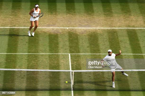 Juan Sebastian Cabal of Colombia and Abigail Spears of the United States return against Jay Clarke and Harriet Dart of Great Britain during their...