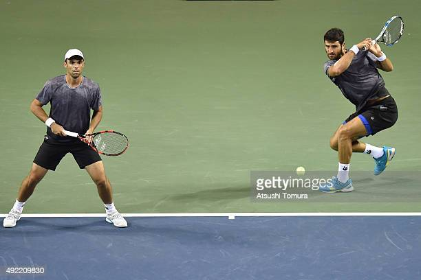 Juan Sebastian Cabal of Colombia and Robert Farah of Colombia compete against Raven Klaasen of South Africa and Marcelo Melo of Brazil during the...