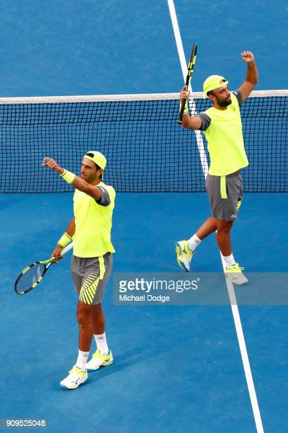 Juan Sebastian Cabal of Colombia and Robert Farah of Colombia compete in their quarterfinal match against Lleyton Hewitt of Australia and Sam Groth...