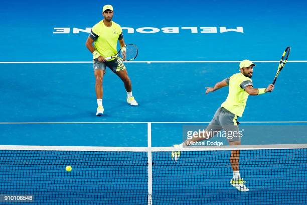 Juan Sebastian Cabal of Colombia and Robert Farah of Colombia compete in their semifinal match against Mike Bryan and Bob Bryan of the USA on day 11...