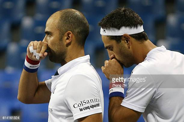 Juan Sebastian Cabal of Colombia and Robert Farah of Colombia discuss during the doubles match against Feliciano Lopez of Spain and Marc Lopez of...