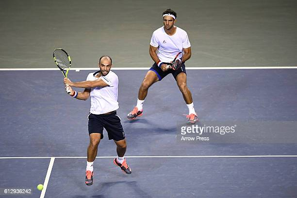 Juan Sebastian Cabal of Colombia and Robert Farah of Colombia in action during the men's doubles quarterfinals match against Jamie Murray of Great...