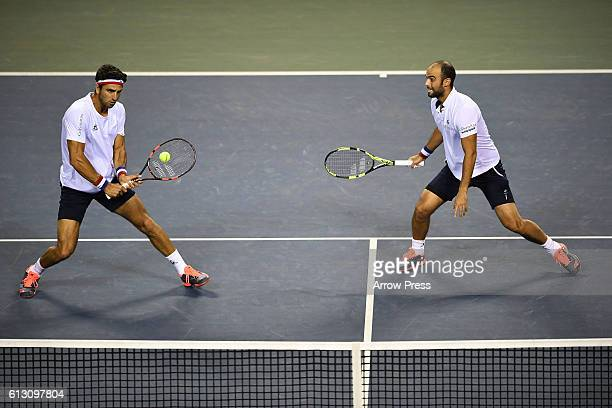 Juan Sebastian Cabal of Colombia and Robert Farah of Colombia in action during the men's doubles semifinal match against Marcel Granollers of Spain...