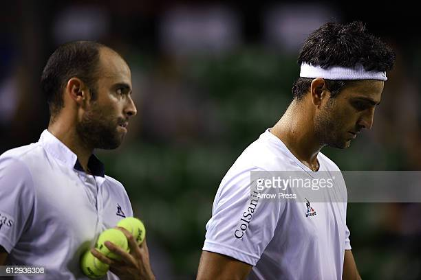 Juan Sebastian Cabal of Colombia and Robert Farah of Colombia leave the court after winning the men's doubles quarterfinals match against Jamie...