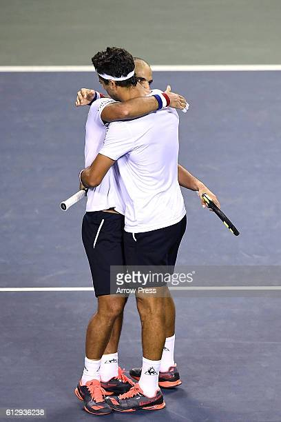 Juan Sebastian Cabal of Colombia and Robert Farah of Colombia react after winning the men's doubles quarterfinals match against Jamie Murray of Great...