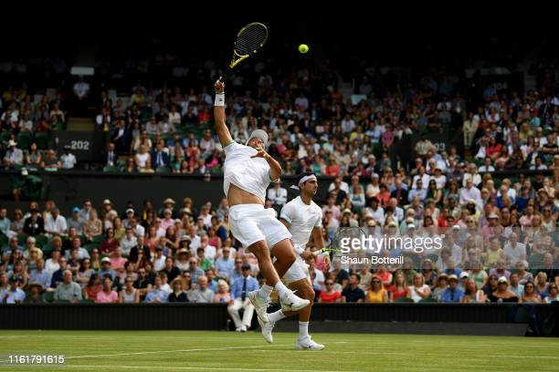 Juan Sebastian Cabal of Colombia, playing partner of Robert Farah of Colombia plays a shot in their Men's Doubles final against Nicolas Mahut of...