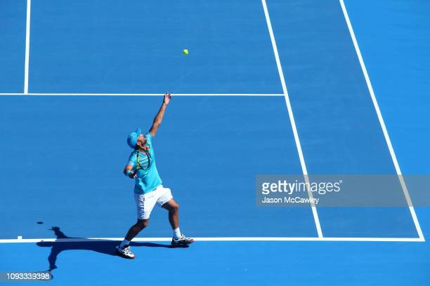 Juan Sebastian Cabal of Colombia serves in the Mens Doubles Final against James Murray of Great Britain and Bruno Soares of Brazil during day seven...