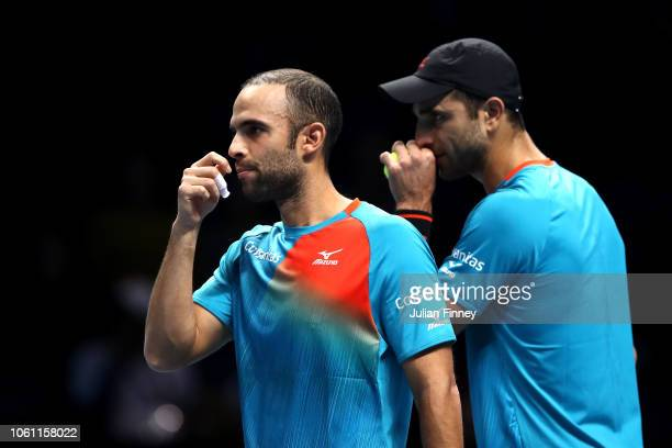 Juan Sebastian Cabal of Columbia and partner Robert Farah of Columbia in conversation during their doubles round robin match against Jamie Murray of...