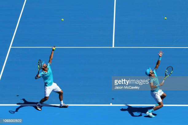 Juan Sebastian Cabal of Columbia and Robert Farah of Colombia warm up prior to the Mens Doubles Final against James Murray of Great Britain and Bruno...