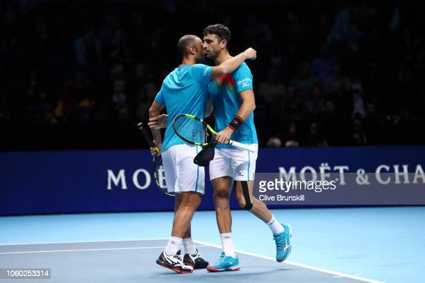 Juan Sebastian Cabal of Columbia and Robert Farah of Columbia celebrate match point after they win their match against Nikola Mektic of Croatia and...